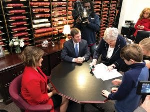 Kentucky Attorney General Andy Beshear, center, watched as Mary Sue Helm, right, reviewed his paperwork to run for governor Tuesday in Frankfort. Beshear is the second Democrat to file for the seat, joining former state worker Geoff Young. Two other Democrats say they are running for governor: state House Minority Floor Leader Rocky Adkins and former Auditor Adam Edelen. (AP Photo/Adam Beam)