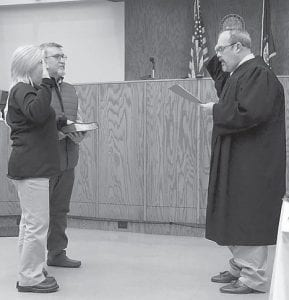 Renee Campbell was sworn in as the Letcher County Cororner on Jan. 6 by Judge James Craft Jr. Also present was her husband, Hagel Campbell.