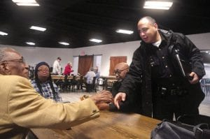 Whitesburg Police Chief Tyrone Fields, right, shakes hands with the Rev. Willie Lamb, 94, of McRoberts before the two spoke at Monday's event. (Photo by Sam Adams)