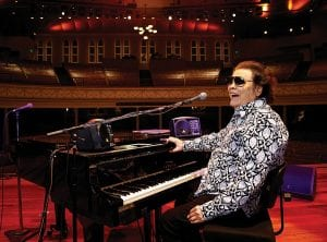 """Ronnie Milsap poses for a photo on the stage of The Ryman Auditorium in Nashville, Tenn. Milsap's new album, """"Ronnie Milsap: The Duets,"""" is out now. (Photo by Donn Jones/Invision/AP)"""