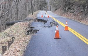 ROAD DAMAGE — KY 1103, a state highway that runs from KY 7 South at Ulvah to KY 160 at Linefork, has collapsed in several places, leaving only a single lane for traffic, including school buses. State highway officials blame the problems on the weather. (Photo by Sam Adams)