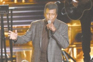 "Charley Pride is seen here performing ""Kiss An Angel Good Morning"" at the 50th annual CMA Awards at the Bridgestone Arena in Nashville, Tenn. Pride finds himself in the spotlight with two upcoming PBS projects: ""Country Music,"" Ken Burns's film on the genre's evolution and the people who created it, and ""Charley Pride: I'm Just Me,"" airing as part of the American Masters series on Feb. 22. (Invision/AP)"