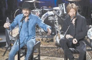 """In this Aug. 12, 2009 file photo, Kix Brooks, left, and Ronnie Dunn of the country music duo Brooks & Dunn, talk about their decision to stop performing together as they answer questions from the audience during a television taping in Nashville, Tenn. The Grammy-winning duo is getting back in the studio together for the first time in a decade to record collaborations with country music's brightest stars. The record called """"Reboot"""" includes classic Brooks & Dunn hits sung with artists like Musgraves and Combs, as well as Kane Brown, Thomas Rhett, Brothers Osborne, Ashley McBryde and more. (AP Photo)"""