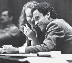 In this July 6, 1979 file photo, serial killer Ted Bundy, right, confers with Margaret Good, a member of his defense team, during jury selection for Bundy's murder trial in Miami, Fla. (AP Photo)