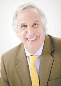 """Actor and author Henry Winkler appears during a portrait session in New York to promote the latest book in his """"Here's Hank"""" series, """"Everybody Is Somebody."""" (Invision/AP)"""