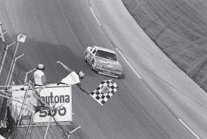 Cale Yarborough of Timmonsville, S.C. drives his Chevrolet to victory in the Daytona 500 stock car race, in Daytona Beach, Fla., Feb. 19, 1984. Yarborough had the fastest qualifying time, won a qualifying race and the 500, a feat never accomplished before at the Daytona International Speedway. (AP Photo/Pete Bauer)