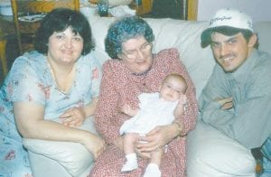 Delores Tacket Holbrook, Dorothy Pennington Tacket holding Lauren Holbrook, and Kenneth Holbrook II