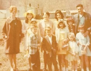 Pictured are (back row) Carol Ison, Charlene Tacket Mason, Freida Boggs Johnson, Dorothy Tacket, Jeanette Tacket Yonts, Marshel Tacket, (middle row) Albert Tacket, Lucille Tacket Graves, (front row) Marshall Ison, unknown, Valerie Ison Horn, and Delores Tacket Holbrook.