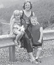 Joyce Baker is pictured with her two grandchildren, Ethan Combs and Jocelyn Baker.