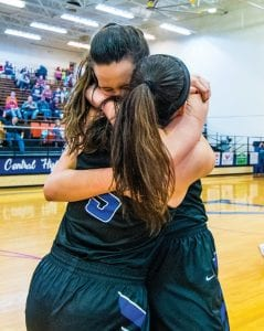 Letcher Central teammates Emma Maggard and Brooke Bates embraced after the final buzzer in their team's 53rd District Championship win over district and region favorite Knott Central. Maggard, a senior, scored 10 points. Bates had 12 points in the upset. (Photo by Chris Anderson)