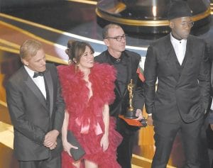 """Viggo Mortensen, from left, Linda Cardellini, Dimiter Marinov and Mahershala Ali accepted the award for best picture for """"Green Book"""" at the Oscars on Sunday at the Dolby Theatre in Los Angeles. (AP Photo)"""