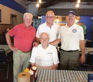 Pictured from left: Gary P. West, writer; Fred James, Prestonsburg businessman; Wayland Mayor Jerry Fultz standing behind King Kelly Coleman in Wayland.