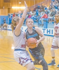 Letcher Central's Kenzie Craft drives to the goal in Monday's loss to Knott Central in the championship round of the 14th Region Tournament. Craft scored four points in the game for the Lady Cougars. (Photo by Chris Anderson)