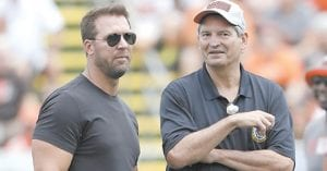 Tim Couch, left, and Bernie Kosar attended practice last summer for the Cleveland Browns, their old team. (AP)