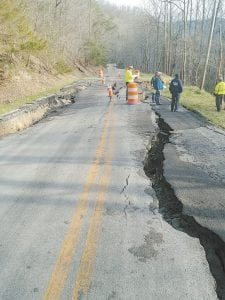 WATER DAMAGES MOUNT – Federal Emergency Management Agency employees inspected damages to KY 1103 at Linefork. The state estimates more than $3 million in damages to state roads alone in Letcher County. The county estimates nearly the same for county roads. (Photo courtesy Letcher Co. Emergency Management)