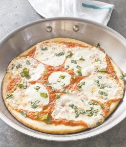 "This photo provided by America's Test Kitchen shows skillet pizza. The recipe appears in the cookbook ""Bread Illustrated."" (America's Test Kitchen via AP)"