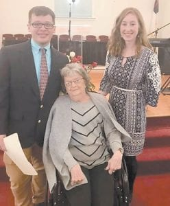 Zach Adams is pictured with his grandmother Helen Bates and his wife Carley Martin Adams at his ordination services.