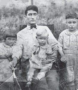 Margie Pennington Adams, Henry Pennington holding Baby James Pennington, and Merill Pennington, probably taken in early 1920's.
