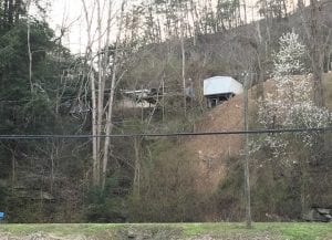 Photos at right show area of Shoemake Drive (top) where slide activity has occurred.