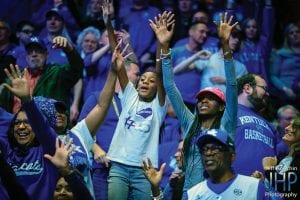 Demetria Caldwell (pink hat) was the SEC Tournament to support her nephew, UK freshman Immanuel Quickley. She took Quickley's 10-year-old sister with her to Nashville. Both planned to be at the NCAA tourney this week in Jacksonville, Florida. (Jeff Houchin Photo)