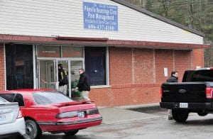 CLINICS CLOSED FOR AT LEAST ONE DAY — Pikeville Neurology Clinic Pain Management locations at Pikeville (above) and Belfry were closed Monday, with a sign on the Pikeville office saying the office would be reopened Tuesday, after representatives of several agencies, including the U.S. Drug Enforcement Administration and Kentucky State Police, showed up at both locations.