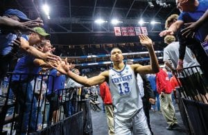 Kentucky's Jemarl Baker Jr. (13) was greeted by fans as he left the court after helping his team defeat Wofford in a second-round game in the NCAA men's college basketball tournament in Jacksonville, Fla., over the weekend. (AP Photo)