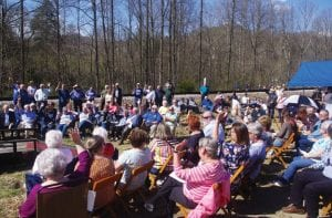 FAMILIES GATHER – Attendees at the dedication of the historic marker for five who died in a March 26, 1966, wreck at the lower Twin Bridge at Letcher hold their hands up to identify themselves as family members of the dead. (Photo by Sam Adams)