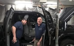 CLEANING UP – Justin Caudill (left) and his father, Curtis Caudill (right), of Little Cowan, have been cleaning cars and houses for the past three years, but now the two are branching out into a pick-up and delivery dry-cleaning service. (Photo by Sam Adams)