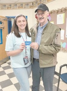 Keisha Niece, a student at Letcher Middle School, was a winner of the Conservation Writing Contest sponsored by Kentucky Farm Bureau and the Kentucky Association of Conservation Districts. Presenting the prize to her is Letcher County Federation President Harold Stanfill.
