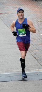 Dr. Fares Khater is seen in photo taken during race in which he qualified for Boston Marathon.