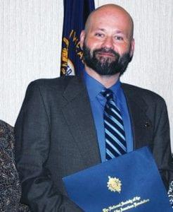 HERBIE BROCK with 2019 Teacher of Year Award.