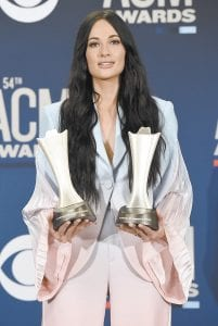 """Kacey Musgraves poses in the press room with the awards for album of the year for """"Golden Hour"""" and female artist of the year at the 54th annual Academy of Country Music Awards at the MGM Grand Garden Arena in Las Vegas. (Invision/AP)"""