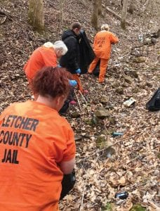 Letcher County Jail inmates have been working hard at cleaning up litter strewn across Letcher County. This photo was taken recently at Fishpond Lake at Payne Gap.