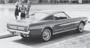 Ford Mustang debuts in '64 The Ford Mustang automobile was officially unveiled by Henry Ford II on April 17, 1964 at the World's Fair in New York, the same day it hit showrooms nationwide. The 1965 Ford Mustang Fastback Model is shown in this photo taken in September 1964. (AP Photo)