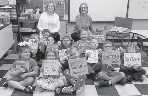 These Arlie Boggs Elementary School kindergarten students recently received books from the Whitesburg Rotary Club.