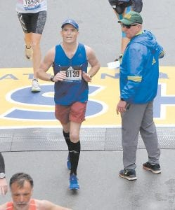 "The words ""run, Fares, run"" were heared many times Monday at MCHC's Whitesburg facilities as employees were updated on Dr. Fares Khater's run in the Boston Marathon. Khater is seen here crossing the finish line in the world-famous race, which attracted more than 26,000 runners."