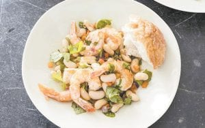 """This photo provided by America's Test Kitchen shows Shrimp with White Beans. The dish was prepared from a recipe appearing in """"The Complete Mediterranean Cookbook."""""""