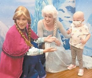 Laney Webb with Disney characters Elsa and Anna