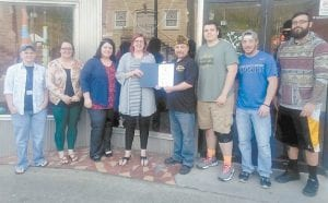 Veterans of Foreign Wars Post 5829 recently presented the Sapling Center in Whitesburg with a certificate of appreciation for Outstanding Service in Community Youth Programs. The Sapling Center is a program of Kentucky River Community Care. Pictured are (left to right) Lee Burke, Meagan Cox, Tonya Johnson, Angie Bush, VFW Chaplain Darren Atkins, Randy Dollarhyde, Joe Glispie and Roscoe Montgomery.