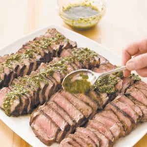"""Argentine Steak with Chimichurri Sauce is seen in this recipe from the cookbook """"Vegetables Illustrated."""" (America's Test Kitchen via AP)"""