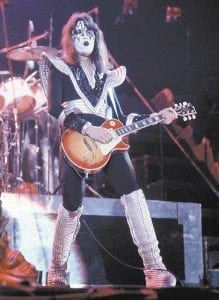 "Photos above and below show Paul ""Ace"" Frehley just a few years after he helped form the hard-rock glam band KISS and how he appears in concert today. Above, Frehley peforms with a Les Paul guitar during a February 1977 concert at the Civic Center in Harford, Conn. Below, Frehley performs in concert in Lancaster, Pa. Frehley will perform in concert at River Park in Whitesburg on May 2. (AP)"
