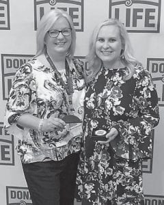 Letcher County Coroner Renee Campbell attended the Gifts for Life Summit held in Lexington, where she received the award for being the top referring coroner for organ donation in the eastern region of Kentucky. Presenting her with the award is Kentucky Organ Donor Affiliates representative Lauren Salyer.