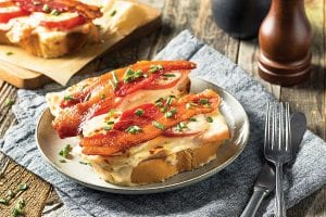 HOT BROWN SLIDER— If you're looking to feed a crowd, these slider versions of the traditional Hot Brown sandwich are the perfect party-sized bites.