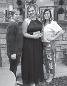 Rose Ballard's daughter Kay Gray and granddaughters Jennifer and Samantha pose for a prom picture.