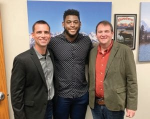 Kentucky defensive lineman Josh Paschal impressed Versailles Baptist Church senior pastor Dr. Michael Cabell, right, with his testimony. FCA area director Aaron Hogue also came with Paschal.