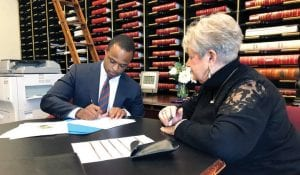 Daniel Cameron, left, a former University of Louisville football player and lawyer for U.S. Senate Majority Leader Mitch McConnell, filled out candidacy papers earlier this year in Frankfort. (AP Photo)
