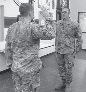 Philip Marshal Graves is pictured reenlisting into the Air Force. His maternal grandparents are Dorothy Tacket and the late Marshel Tacket.