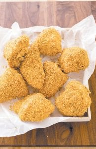 This photo provided by America's Test Kitchen shows oven fried chicken.