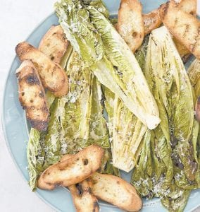 """This photo provided by America's Test Kitchen shows Grilled Caesar Salad. This recipe appears in the cookbook """"Vegetables Illustrated."""""""