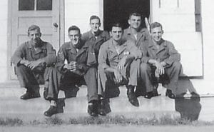 This photo was taken at Lackland Air Force Base, Texas, at the base printing department in 1950 when the Korean War started. Everett Vanover is in front of some of his men taking a break.